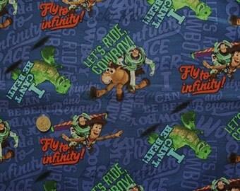Disney Pixar Buzz Lightyear Woody Toys Toss Blue Fabric - Half Yard