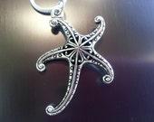 "Starfish filigree metal pendant on 18"" sterling silver chain"
