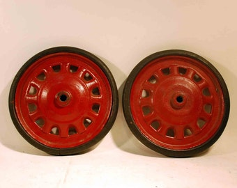 two vintage cast iron wheels red painted metal and solid rubber tires 9 1/2 inch