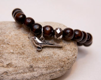 Bird charm bracelet, wood bead bracelet, freedom symbol, bird charm, bird jewelry, wood bead stack bracelet, layer charm bracelet, free bird
