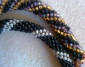 Bead Crochet Bracelets: Beaded Bracelet, Gold, purple and black and Silver and black