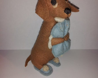 cute vintage felt Dachshund dog doll made in England wearing blue slippers and holding a pillow 5 1/2 in