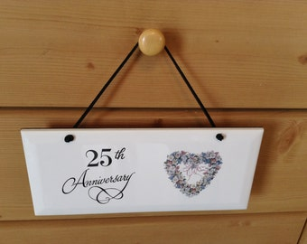 Ceramic Plaque  it is 4 1/4 by 10 With 25 th Anniversay