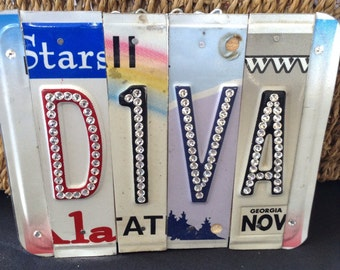 Custom recycled plates forming the word with Swarovski crystals