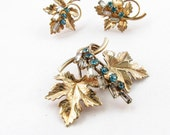 Vintage gold filled rhinestone and maple leaf brooch and earrings set signed Carl Art