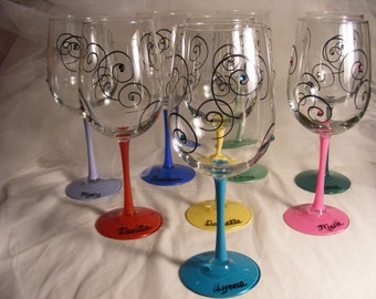 large oversize custom painted wine glasses in assorted colors with Swarovski crystals.  Can be personalized for birthday or bridesmaids