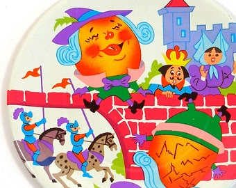 60's Tin Toy Tea plate, Humpty Dumpty storybook graphics. Larger size.
