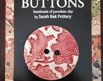 Porcelain button in red and white, extra large with floral paisley texture