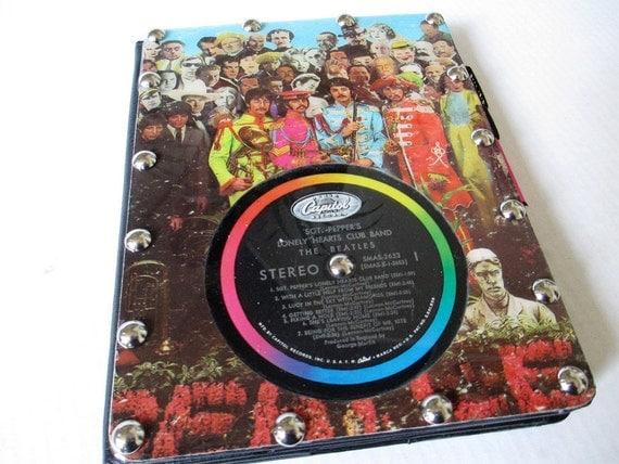Unique iPad case, folio style featuring vintage Sgt. Pepper Beatles record album