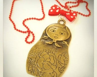 Tattoo Matryoshka Russian doll necklace, red bow