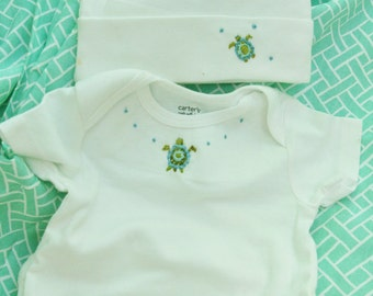 Short sleeved onesie aqua colors turtle with matching hat 12 month size hat one size up to 12 months
