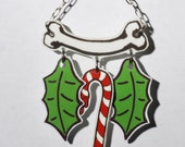 creepy Christmas ornament with bone, holly leaves and dripping candy cane ORN-31