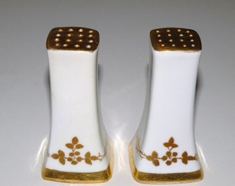 Antique Bavarian Porcelain ivory and gold decorated salt and pepper shakers
