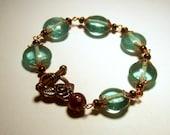 Aqua Glass Puffed Ovals Hand-Linked Bracelet Copper Flower Toggle Clasp Accent