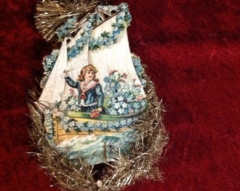Victorian Tinsel Girl on a Boat Cut out Christmas Ornament (0-54)