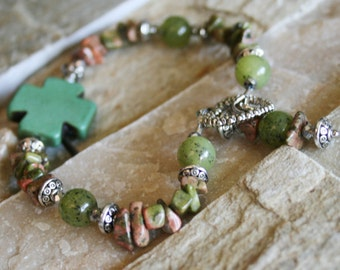 Green stone bracelet, sideways cross, rustic cross, natural stone jewelry, multi stones chips