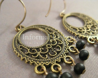 Brass Earrings with exotic intricate design and dangling black glass beads