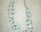 Triple Strand Silvertone Serpentine Chain with Bevel Cut Baby Blue Beads