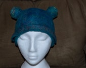 This is a close fitting 22 1/2 inch martian skull cap winter hat, deep turquoise, blue, purple and chartreuse