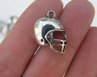 8 American football helmet charms antique silver tone SP12