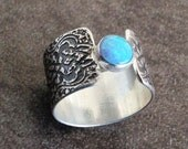 Blue opal sterling silver ring with arabesque pattern texture wide band
