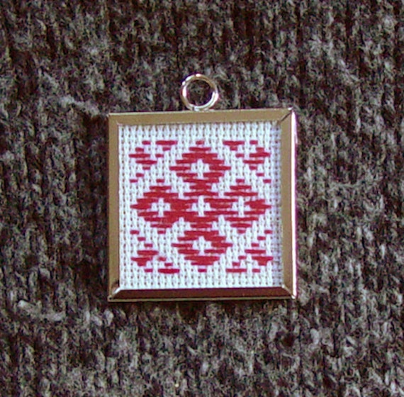 Blessing of the Creator Pendant Talisman. Handmade embroidery placed into a metal frame with glass. 1.5in by 1.5in