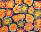 Vera ladybug scarf with meadow of daisies. Orange, red, olive, black, flower power, hippie era.