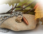 Bullet Necklace with 45 ACP casing and 30 caliber copper projectile great for guys
