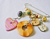 "Lovely kilt pin brooch with wooden beads and charms - ""Trees I have Loved"" with apple and heart charms. Cute and quirky."
