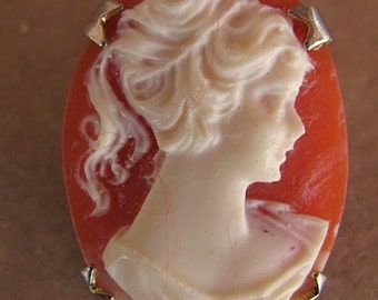 Small vintage cameo pin of a lady profile with pony tail
