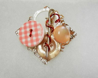 Button and needle brooch