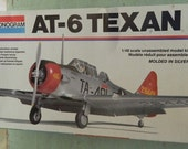 Vintage 1979 model airplane kit  AT-6 Texan 1/48 Monogram 5306 Military aircraft  includes figures of Pilot & Flight Instructor  Made in USA