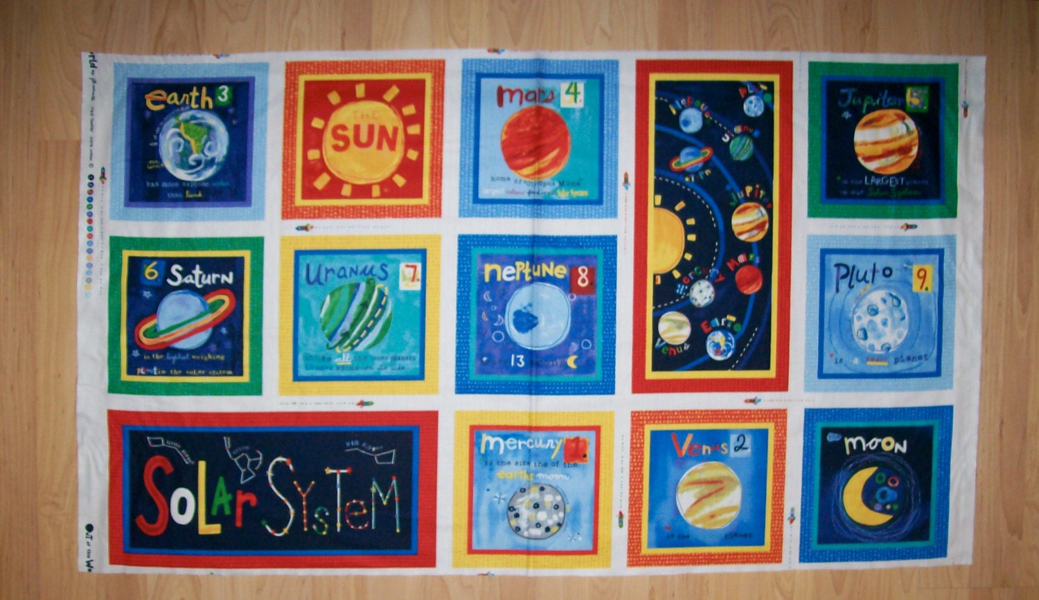 An awesome out of this world solar system with all the planets for Solar system fabric panel