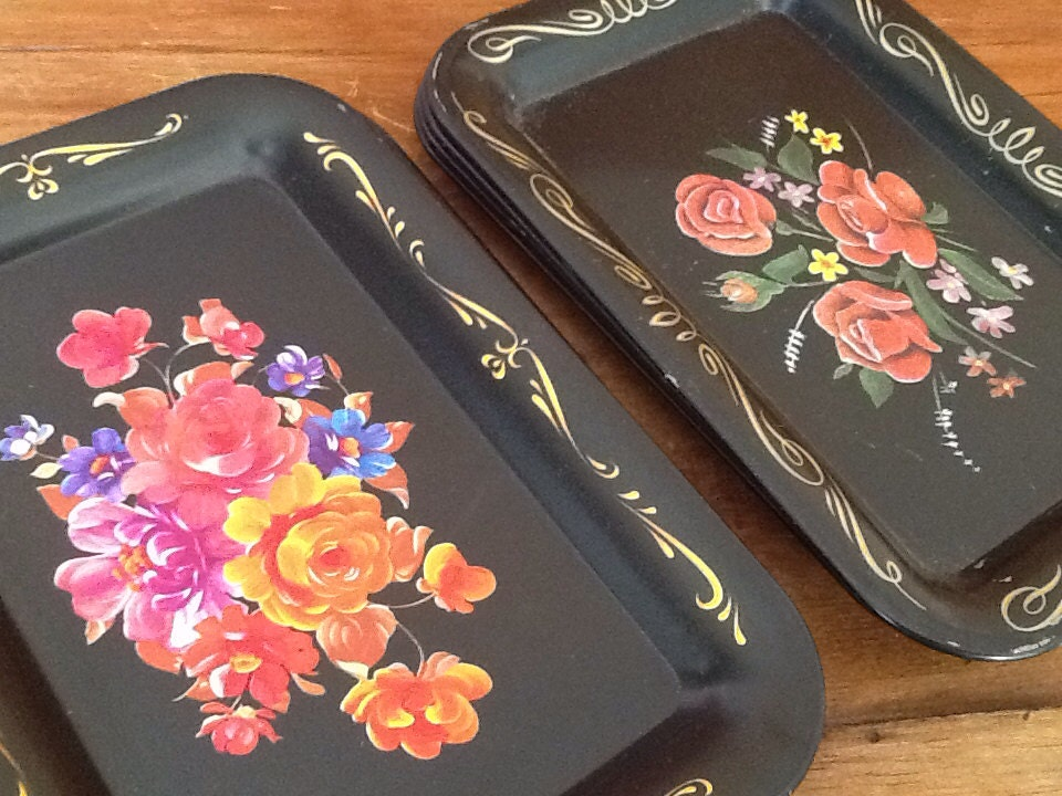Nine floral on black canap trays for Canape trays