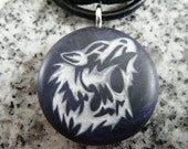 Wolf pendant hand carved on a polymer clay midnight blue pearl color background.  Pendant comes with a FREE 3mm necklace.