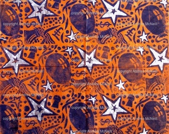 Sheet orange tissue paper handprinted with party design linoprint