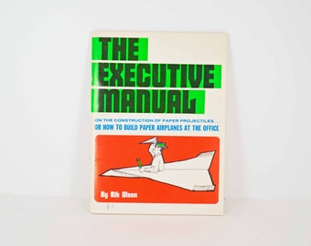 The Executive Manual by Rik Olson - Paper Airplanes Building Executive Humor