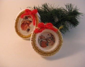 homespun christmas ornaments juvenile theme set of 2 plastic disks gold trim red bows
