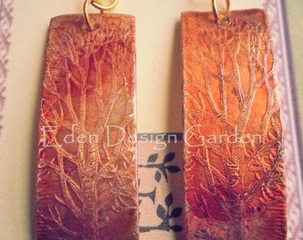 Etched metal rectangular earrings with leafless tree-terracotta and rust