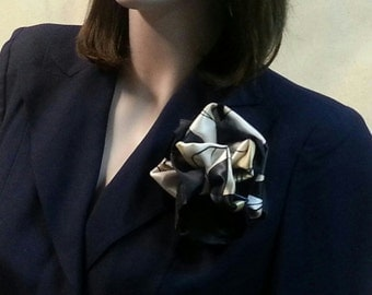 Fabric blossom and button broach -