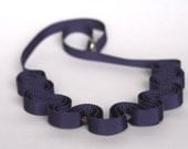Ribbon necklace in violet with glass beads