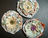 set of three paper lollipop style flowers with button centers