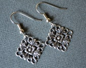Antiqued Silver Flowers in Diamonds . Earrings