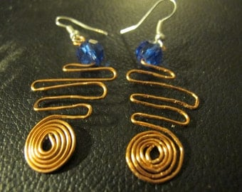 Copper wire wrapped earrings with spirals blue beads