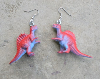 DINOSAUR Earrings...dangly. novelty. dino. retro. science. kitsch jewelry. plastic toy. purple dino. jurassic park. red dino. t rex.