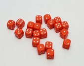 20 Vintage Fun Orange Plastic Dice measuring 1/2 inch by 1/2 inch square.