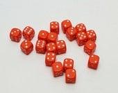 20 Vintage Fun Orange Plastic Dice measuring 1/2 inch by 1/2 inch square.