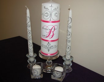 Five Piece Personalized Unity Candle set made with a swirl design of rhinestones and fushia ribbon
