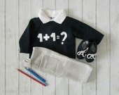 Knitted sweater, trousers and booties. Set in grey and dark blue. 100% wool. Made To Order.
