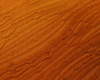 Earth tones candle accent mat - textured oranges and browns
